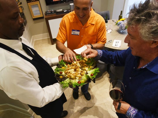 Jerry Williams. left, hands out Chef Alvin Coleman's hors d'oeuvres to Bryan Vekovius and Richard Biernacki during the Society of Golden Fork dinner Monday evening.