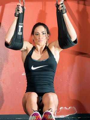 Christina Heine, a first-year grad student at University of West Florida, started her physical fitness regime in 2013 and one of her harder exercises are these hanging leg lifts.