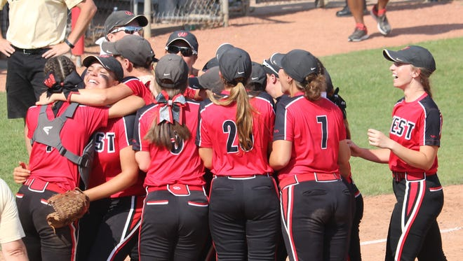 The Lakota West softball team celebrates after getting the final out of their state semifinal win May 31.