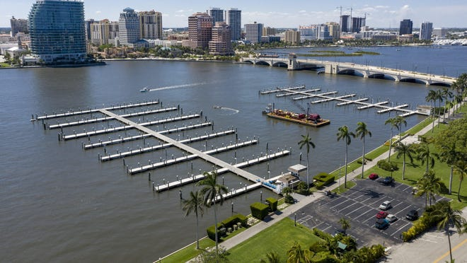 All the yachts are gone and a barge moves into place on May 1 when the Palm Beach Town Marina was closed for a $38 million reconstruction. Lake Drive Park, partly visible, also will be renovated.
