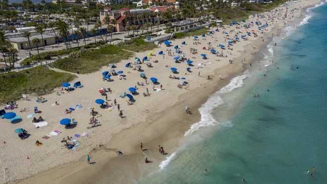 Lake Worth Beach is filled with beachgoers  on March, 16, 2020 in Lake Worth Beach, Florida. The Town of Palm Beach is closing its beaches beginning Tuesday Ñ following the lead of spring break-harried Fort Lauderdale and Miami Beach help curb the spread of the coronavirus. Palm Beach County leaders said they had no immediate plans to bar visitors from their 14 public beaches and inlet parks.