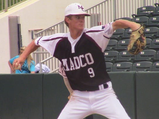Madison County's Dylan Bass pitches against Port St.