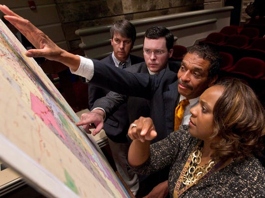 Alabama lawmakers studying proposed election maps in 2012, several years before the Supreme Court struck them down over the use of race.