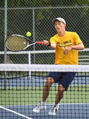 Hillsdale's Kreyzon Philipp returns a serve Monday night. Philipp was one of three Hillsdale singles players to get wins against Columbia Central to help the Hornets pick up a second straight win. Sam Fry/Daily News.