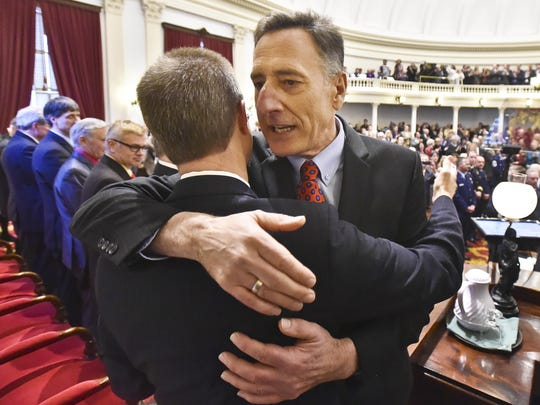 Gov. Peter Shumlin hugs Speaker of the House Shap Smith during his inauguration ceremony at the Statehouse in Montpelier on Jan. 8.