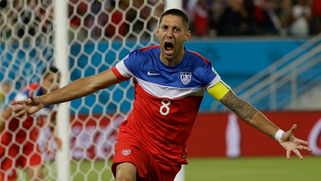 United States' Clint Dempsey celebrates after scoring the opening goal during the group G World Cup soccer match between Ghana and the United States at the Arena das Dunas in Natal, Brazil, Monday, June 16, 2014. The United States won the match 2-1.
