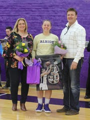 Albion College senior Tierra Orban (center) with her parents, Regina and David Orban.