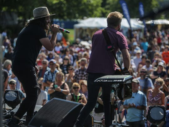 Jordan Feliz, left, and his band perform at the Christian music festival Fish Fest at Riverfront City Park in Salem, Oregon on Aug. 19, 2017.
