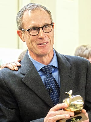 Tuttle Middle School teacher Jay Hoffman smiles as he named the Vermont teacher of the year in November 2012.