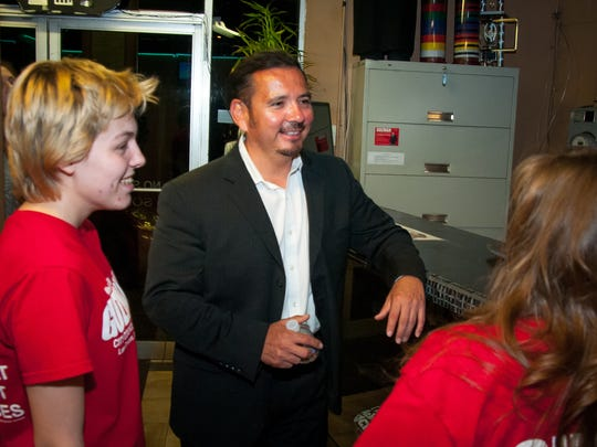 District 1 city council candidate Eli Guzman talks with supporters during an election night watch party at his Sport Karate Kickboxing business.
