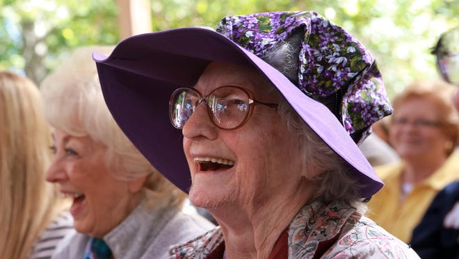 Violet Hensley celebrated her 100th birthday at Silver Dollar City where she has demonstrated her fiddle making craft for 50 years. She was born on Oct. 21, 1916. Violet Hensley enjoys the celebration.