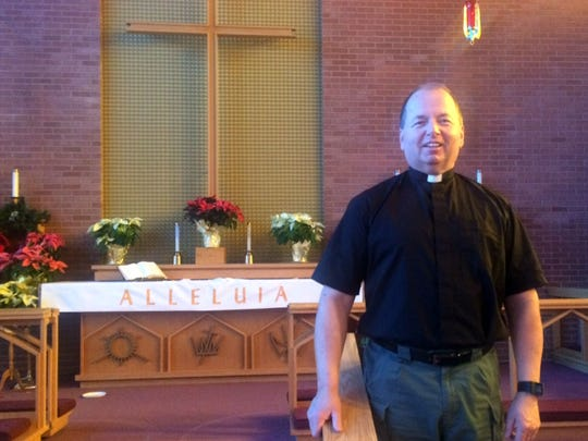 Richard Bartholomew, pastor at Grace Lutheran Church in Omro, is among 20 ordained or licensed clergy throughout the state who are serving the Wisconsin State Patrol as volunteer chaplains in a new support program for agency employees and their families. Bartholomew is pictured on the altar at his church.