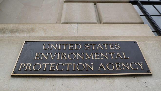 This Sept. 21, 2017 file photo shows the Environmental Protection Agency (EPA) Building in Washington. Criminal prosecution and convictions of polluters haven fallen to quarter-century lows under the Trump administration. That's according to Justice Department figures for fiscal year 2019. The EPA says it's improved in some other enforcement categories. But a former EPA agent in charge says three years of declines show the agency dismantling criminal enforcement. (AP Photo/Pablo Martinez Monsivais)