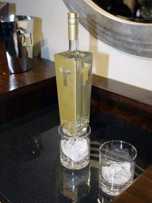 A bottle of Trump vodka sits on a bar.
