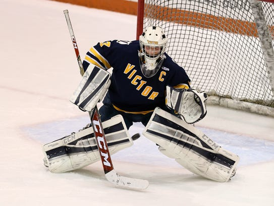 Victor goalie Chayse Ierlan makes a save in a game
