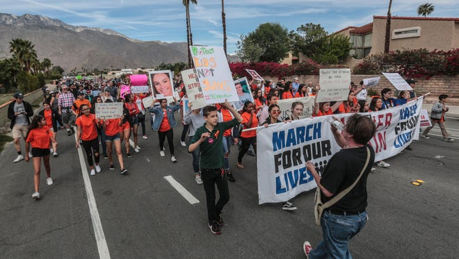 Palm Springs March for Our Lives participants march from Palm Springs High School to the Palm Springs City Hall  on Saturday, March 24, 2018. The Palm Springs march is one of 800 around the world calling for gun restrictions.