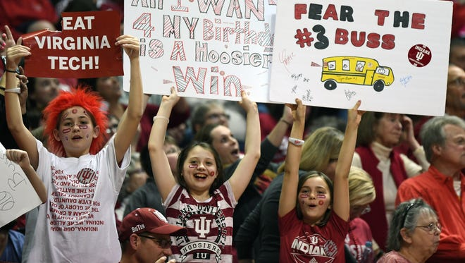 Young fans hold up signs during the game against Virginia Tech at Simon Skjodt Assembly Hall in Bloomington, Ind., on Saturday, March 31, 2018.