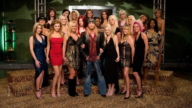 Michaels pictured with the cast of Season 1 (2007) from the VH1 series, Rock of Love, intended on finding Michaels a match.