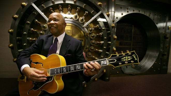 Don Davis was a producer for Motown and then for competing label Stax. He went on to be CEO of the First Independence Bank in Detroit. Davis posed for a photo with his Johnny Smith guitar in front of an antique vault at the basement of his bank, Jan. 6, 2009.