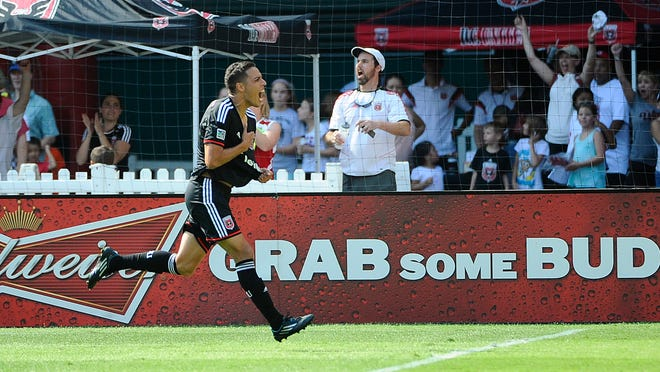 DC United midfielder Luis Silva (11) celebrates after scoring a goal against the New York Red Bulls during the second half at Robert F. Kennedy Memorial.