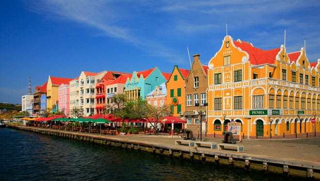 Eye candy for photographers, the pretty promenade is wildly colorful with eye-catchers like the bright yellow Penha building built on the corner in 1708.