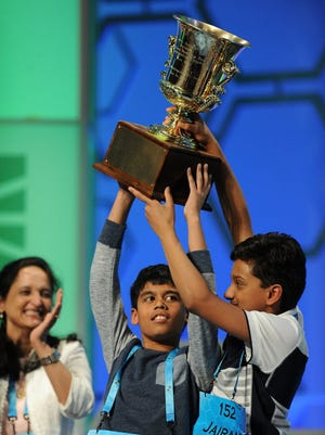 Nihar Janga, 11, of Austin, Texas (L), and Jairam Hathwar, 13, of Painted Post, N.Y. (R), celebrate as co-champions during the 2016 Scripps National Spelling Bee at the Gaylord National Resort and Convention Center in National Harbor, Md.