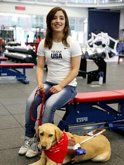 Las Crucen Letticia Martinez, a fully blind swimmer, will compete in the 2016 Paralympics in Rio de Janeiro. She is shown here with her guide dog, Philly.