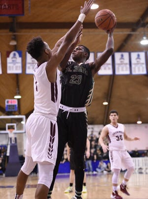 Isaac Hippolyte (23) and St. Joseph topped New York's Thurgood Marshall, 78-53, on Sunday at the Public vs. Private Challenge at Dwight Morrow in Englewood.
