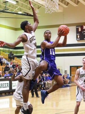 Eastside's Pantry Mckinney (11)  shoots for two against Greer in basketball action Tuesday Jan. 31, 2017.