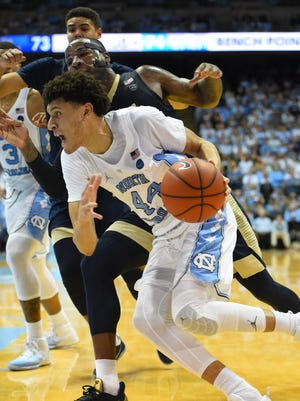 North Carolina forward Justin Jackson (44) drives to the basket as Pittsburgh forward Michael Young (2) defends in the second half.