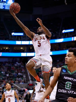 Arizona guard Kadeem Allen (5) moves to the basket against North Dakota during the second half.