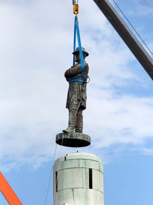 A statue of Robert E. Lee is removed in New Orleans in May 2017.
