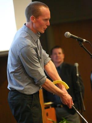 Entrepreneur Sam Hunt demonstrates his PrecisionLAG golf training tool.