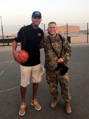 Former NBA player Kevin Martin, left, poses with fellow