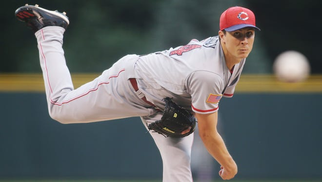 Jul 4, 2017; Denver, CO, USA; Cincinnati Reds starting pitcher Homer Bailey (34) delivers a pitch during the first inning against the Colorado Rockies at Coors Field. Mandatory Credit: Chris Humphreys-USA TODAY Sports