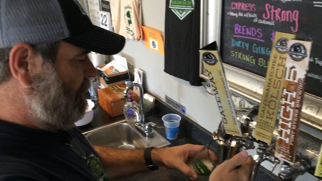 Owner Rob Whyte pours a pint of his brewery's Gateway Gold, a honey blonde ale.