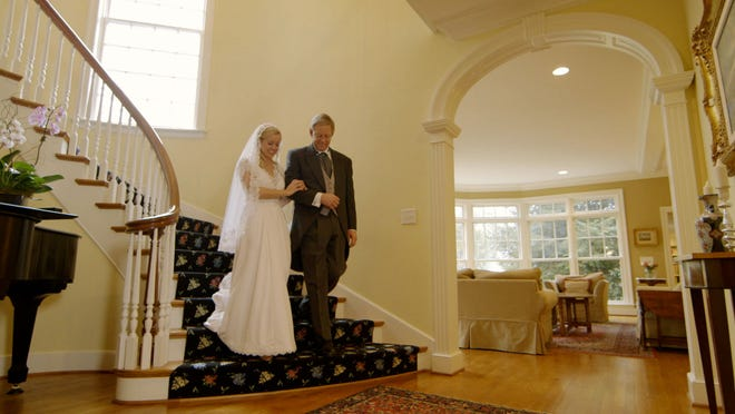 Actors portray a wedding scene for the mini movie made to market a home in Raleigh, N.C.