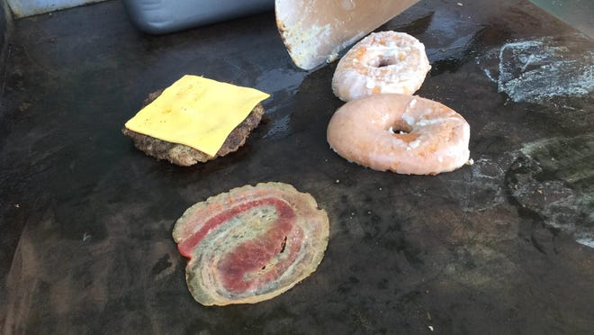 A Glazer burger at Wisconsin Rapids Rafters games includes a sliced Glazer doughnut, cheeseburger and bacon.