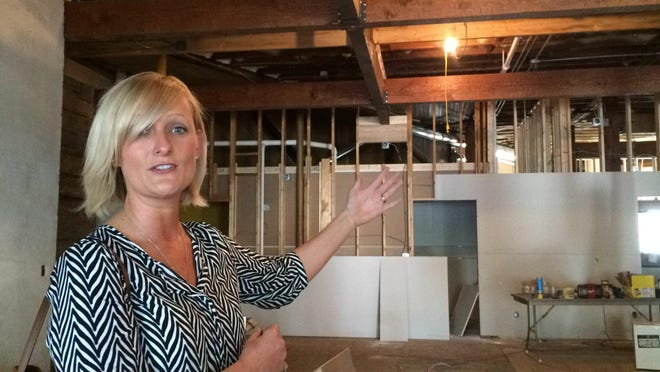 Laura Nelson of the Wisconsin Rapids Area Convention & Visitors Bureau talks about the layout of the organization's new location in downtown Wisconsin Rapids. The organization will be accessed from Second Street South.