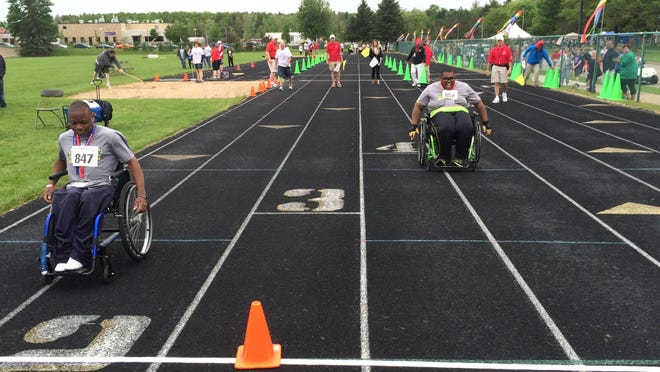 Antonio Davis, left, and King Hall, both of Milwaukee, compete in the 25-meter wheelchair race at Coleman Track on the University of Wisconsin-Stevens Point campus on Friday. The event is part of the Special Olympics Wisconsin Summer Games.