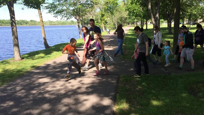 Families begin Kids Walk Wisconsin on Saturday morning at Pfiffner Pioneer Park in Stevens Point. The event was held in conjunction with the annual Walk Wisconsin.