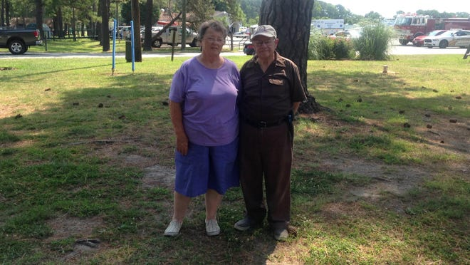 Joyce and Freddy Lilliston of Wachapreague, Virginia stand a year later in the spot where their camper-trailer was, with them inside, during the tornado that struck Cherrystone Campground in Northampton County, Virginia on July 24, 2014.