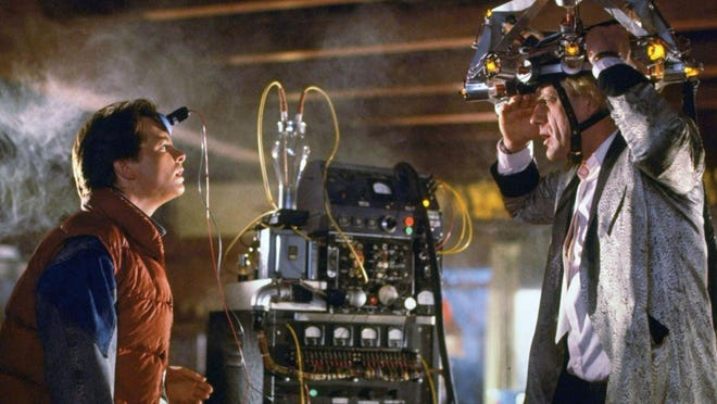 """Michael J. Fox, left, and Christopher Lloyd jump back in time in 1985's """"Back to the Future."""""""
