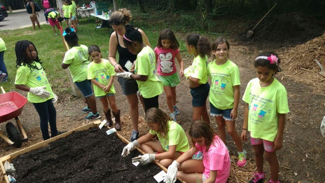 Frenchtown Heritage Hub installs its Living Classroom at the Frenchtown Farmers Market on Saturday. The raised garden beds were installed Tuesday with the help of campers from Oasis Center for Women & Girls.