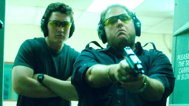 """Miles Teller and Jonah Hill star as arms dealers who are in way over their heads in """"War Dogs."""""""