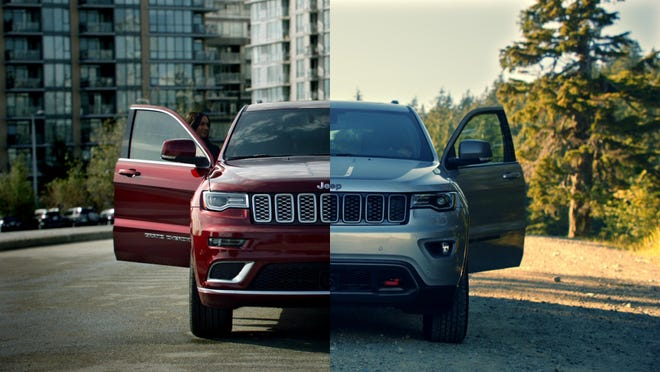 """A still of Jeep's newest ad that began airing Monday for its """"Free to Be"""" ad campaign. It depicts people with different political affiliations and lifestyles driving red 2017 Grand Cherokee Summit models and blue 2017 Grand Cherokee Trailhawk editions."""