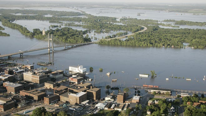 Flood ravages Burlington and swallows Gulfport, Illinois, June 17, 2008, as record river levels fall and levees break.
