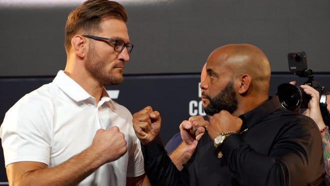 UFC heavyweight champion Stipe Miocic (left) and Daniel Cormier face off at a press conference for UFC 252. MMA Junkie