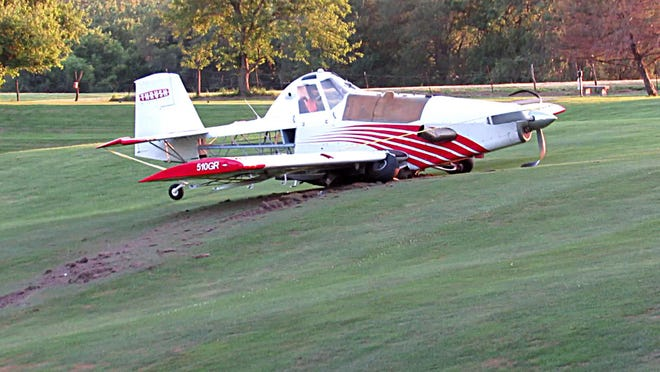 A crop-dusting airplane is shown Sunday at Elk's Fairview Golf Course in Keokuk after making an emergency landing there.
