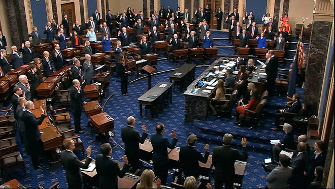 WASHINGTON -- In this image from video, presiding officer U.S. Supreme Court Chief Justice John Roberts swears in members of the Senate for the impeachment trial against President Donald Trump at the U.S. Capitol on January 16.